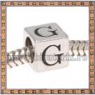 Margica argintie 6.4mm Litera G